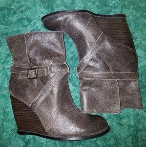 BCBG Paris distressed leather wedge boots.